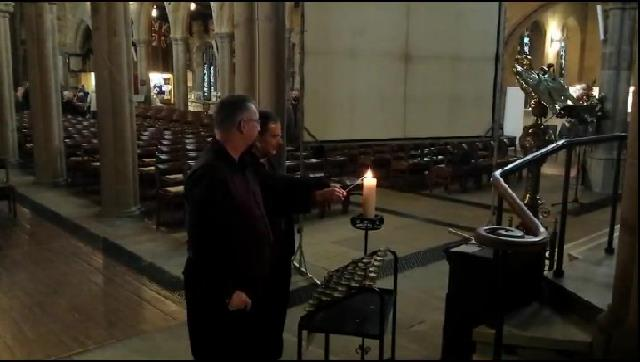Bishop Toby and Mike Haines light a candle