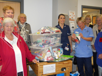 Mothers' Union members giving packs to Pinderfields hospital