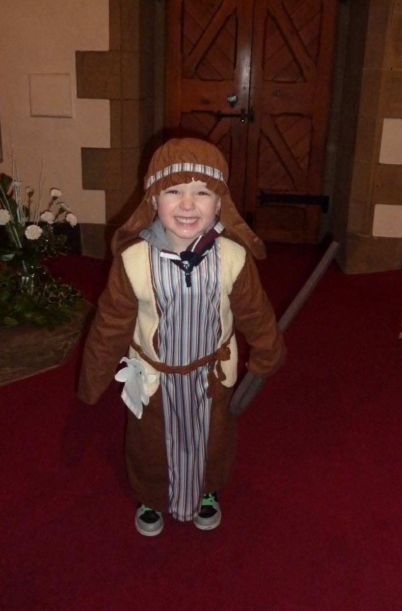 Little boy dressed as a shepherd