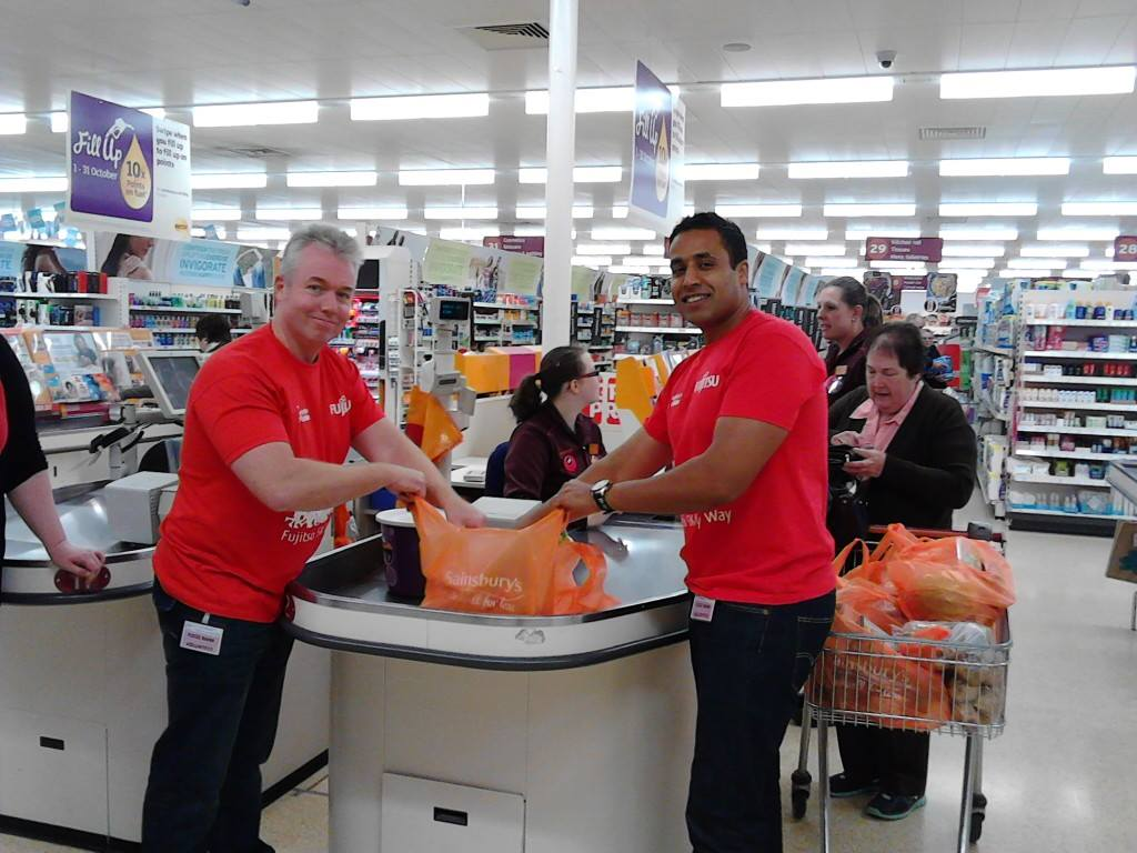 Fujitsu employees helping at the bag pack