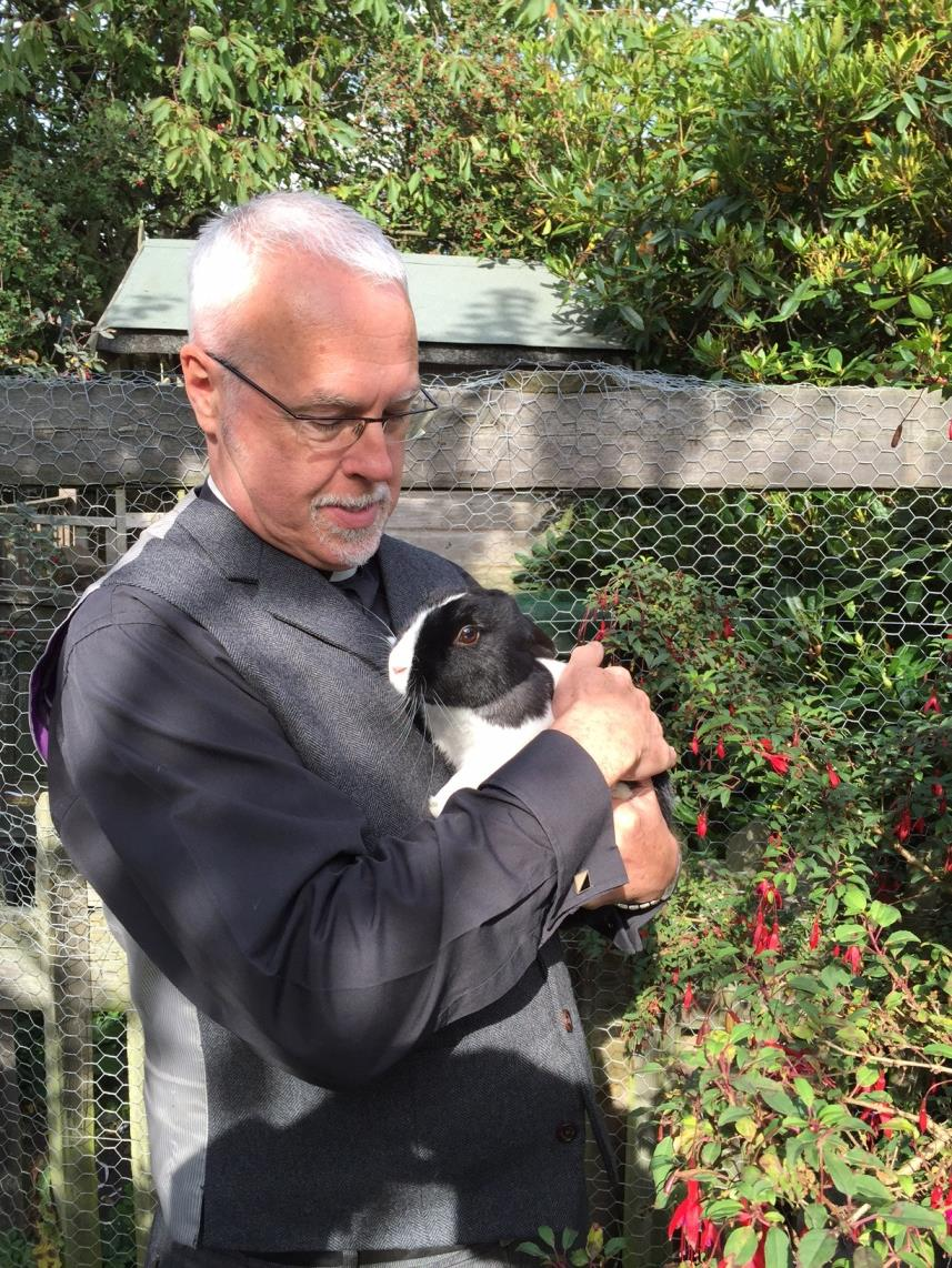 Revd. Jack Parkes, curate of Cleckheaton, holding Sebastian the rabbit