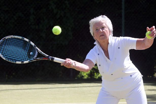 Mary Durrans playing a game of tennis