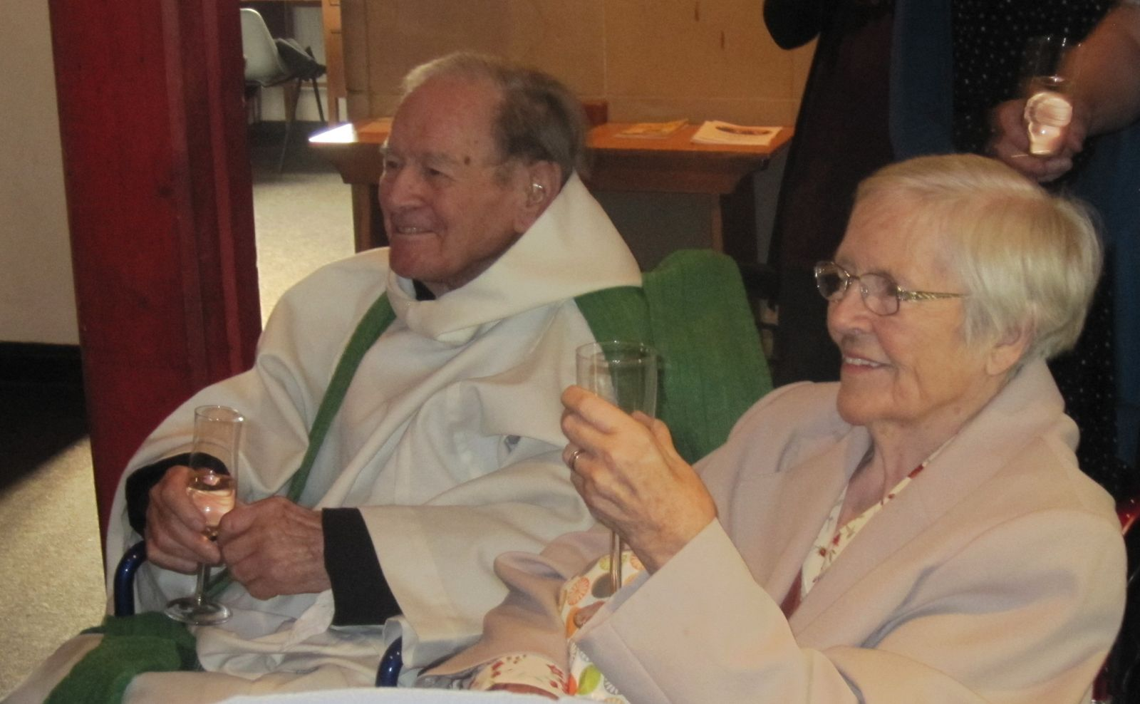 Canon Leslie Chadd enjoys a well deserved glass of bubbly with his wife, Margaret at their double celebration of his 70 years a priest and 60th wedding anniversary