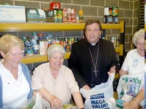 Bishop Tony helping at a foodbank