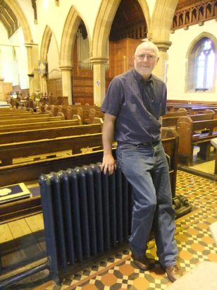Vicar on radiator in large church