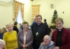 Bishop Tony and vicar, Maureen Browell with those who made the first Dementia Friendly Christmas lunch such a success