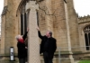 Dean Jonathan and stonecarver, Celia Kilner with the new Saxon Cross