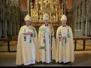 Bishop Nick, together with Bishops James and Tony receive new vestments for the new diocese
