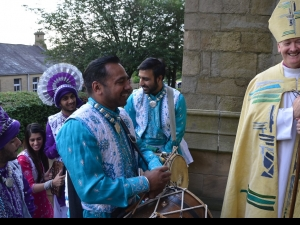 Bishop Nick welcomed in with the Punjabi Dance Academy