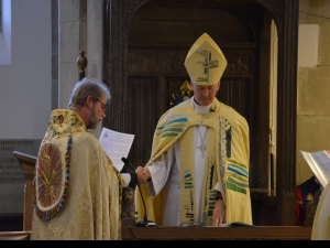 Dean, Jerry Lepine places Bishop NIck in the Episcopal Chair or Cathedra