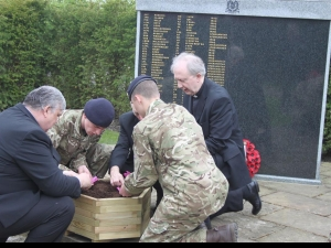 Junior soldiers plant in the memorial garden with Bishop James