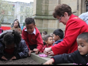The Mayor of Wakefield  helps children from St Mary's plant poppies