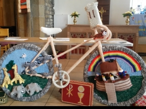 Yarn bombing a bike at the Dewsbury pre Le Tour Arts and Culture Festival