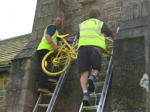Rob and Dave hang out the yellow bicycle for a big welcome from Blubberhouses