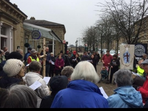 Christians walk through the streets of Ilkley with a cross to recall  Jesus walking through the streets of Jerusalem with his cross.