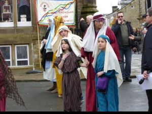 Young onlookers follow Jesus to his trial at Settle Passion Play