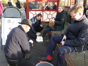 Clergy from St Mary's, Burley-in-Wharfedale,  Alastair Kirk and Paul Wheelhouse offering a free 'shoe shine' to rush-hour travellers – a modern slant on 'foot washing'.