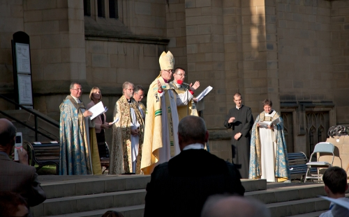 Bishop Nick greets and prays with those gathered outside