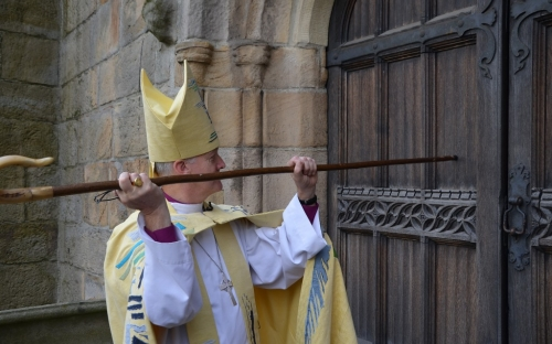 Bishop Nick knocks on the door of Bradford Cathedral which is opened to welcome him in the name of Christ.