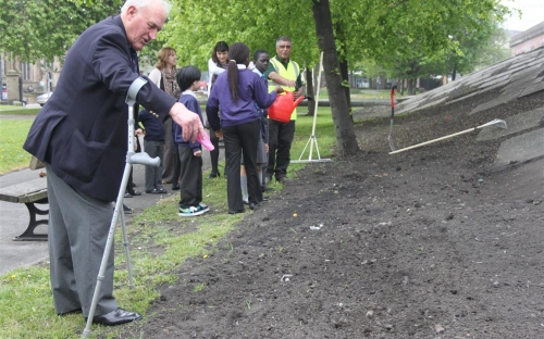 David Marshall from the Royal British Legion helps scatter seed