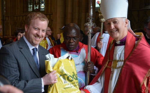 Every member of the congregation received a Morrison's goody-bag and Bishop Nick and Archbishop John Sentamu meet Morrisons representative Guy Maso