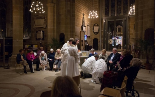 Foot washing - a sign of serving others - at the Maundy Service, Wakefield Cathedral