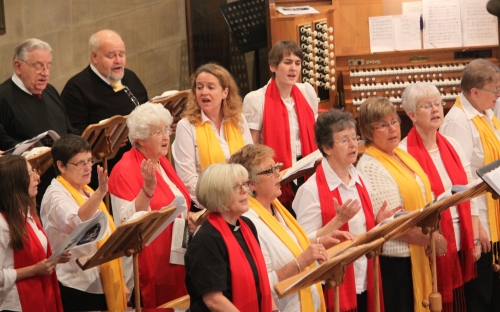 The Minster Singers and the Gospel Whispers warm up before the service