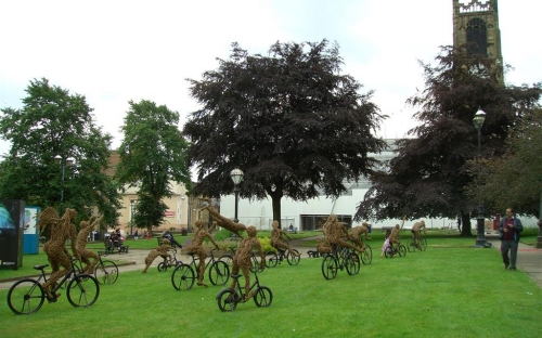 Wicker cyclists outside Huddersfield Parish Church