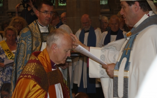 Bishop Tony and Bishop James annoint Bishop Nick and pray that the Holy Spirit will strengthen him in his ministry