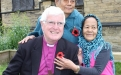 Bishop Tom wearing a knitted poppy made by St Stephen's Bowling