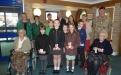 Young and old at a Royal British Legion Poppy Home getting ready to plant