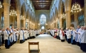 Children,clergy and many others welcome the Bishop into Wakefield Cathedral