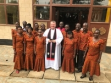 Choirs and fire eaters when Fr Bob Cooper was installed as canon in Musoma Cathedral Mara